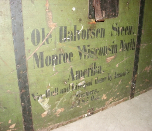 An immigrant trunk marked with the travel route from Norway to America, from the collection of the Mondovi Area Historical Society.